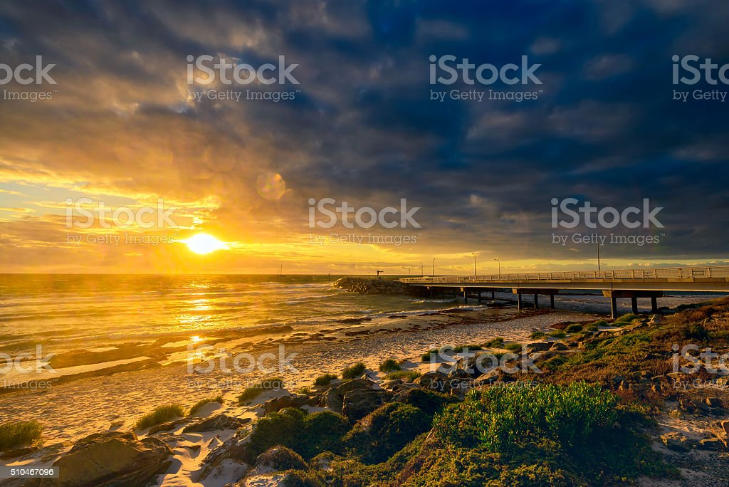 Dramatic stormy sunset at West Beach, South Australian coast stock photo