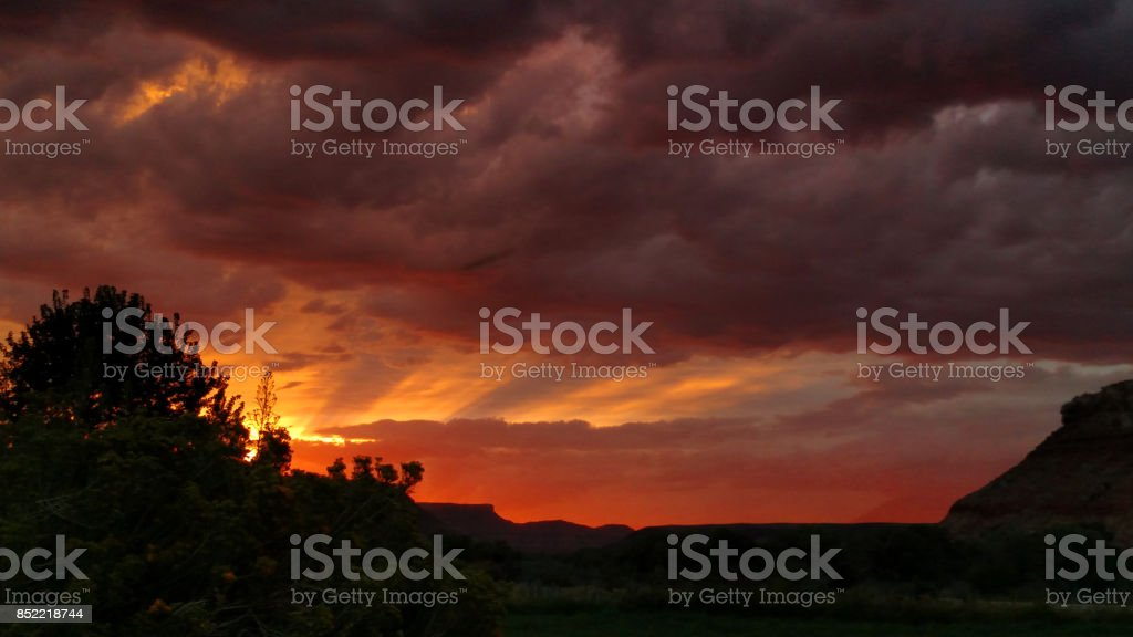 Dramatic stratus and cumulus clouds at sunset over the Virgin River valley near Zion National Park Utah stock photo