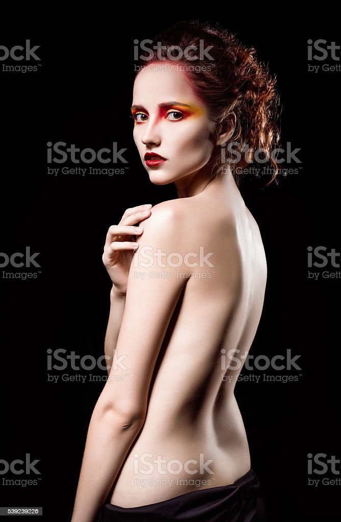 Dramatic studio portrait of lovely sad ginger woman royalty-free stock photo