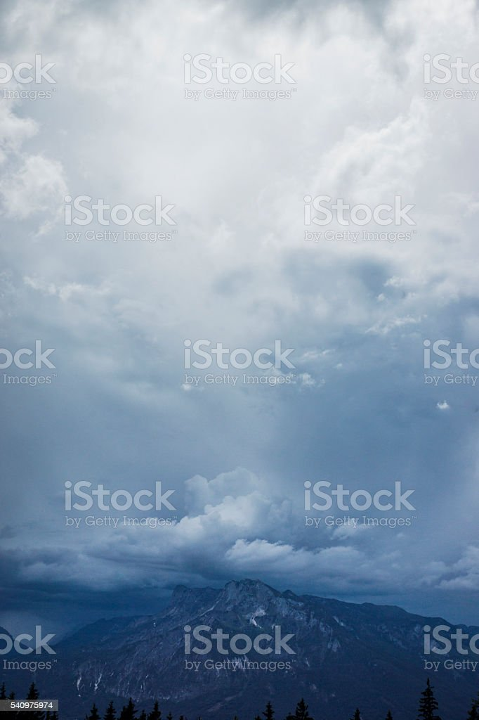 Dramatic Summer Cloudscape Over the Alps stock photo