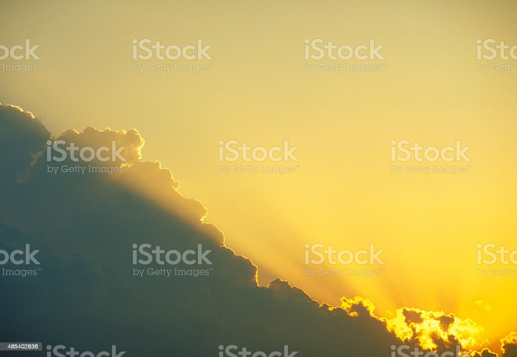 Dramatic Sunbeam and Cloud at Sunset stock photo