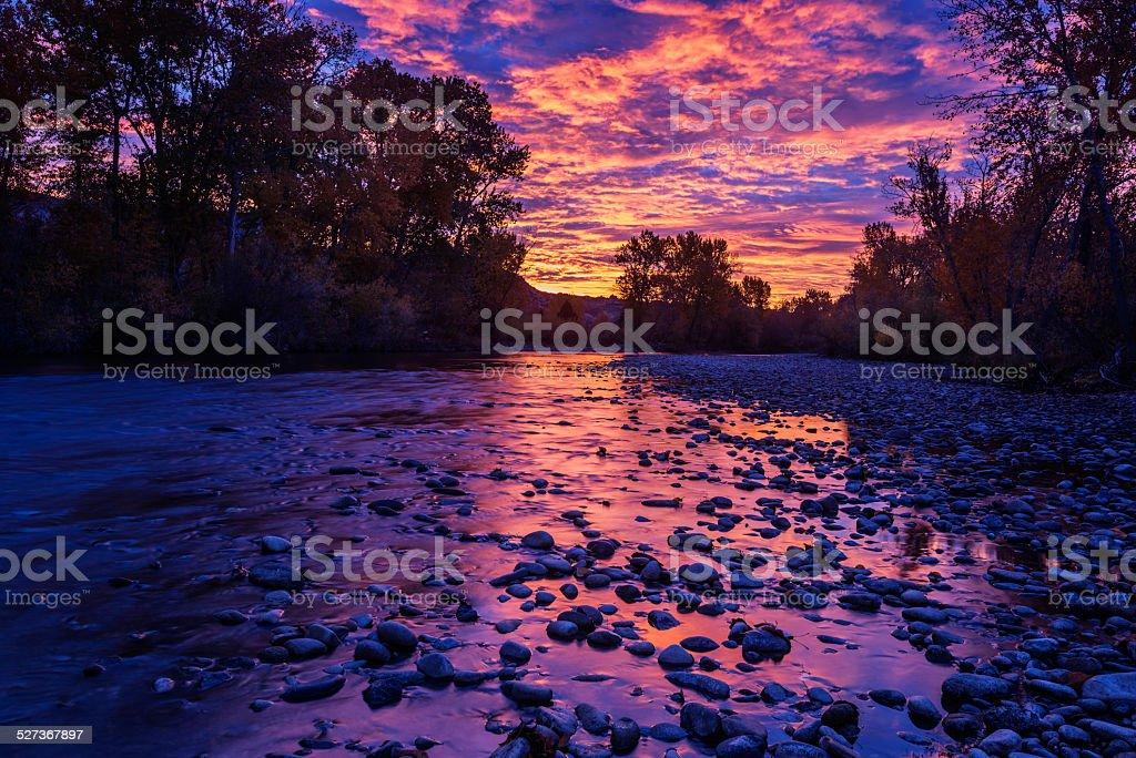 Dramatic sunrise over Boise River stock photo
