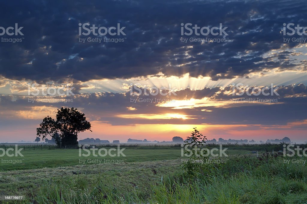 dramatic sunrise over pasture royalty-free stock photo