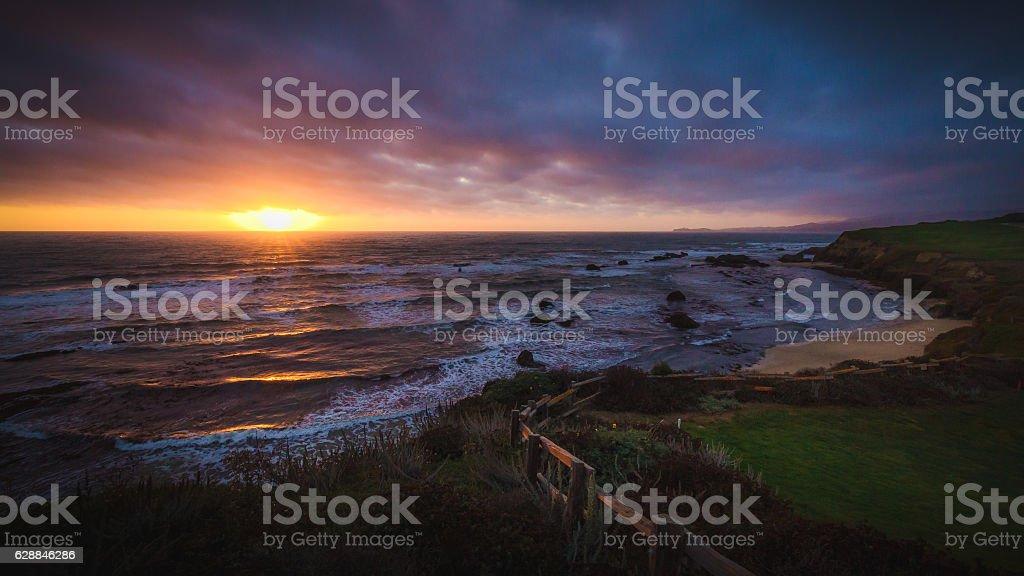 Dramatic sunset at Half Moon Bay beach stock photo