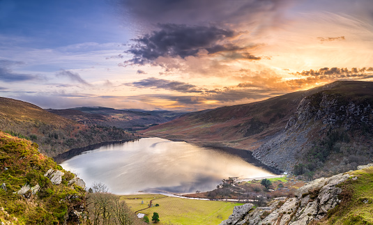 Dramatic sunset at Lake Lough Tay or The Guinness Lake in County Wicklow where Vikings village, Kattegat was located, Wicklow Mountains, Ireland