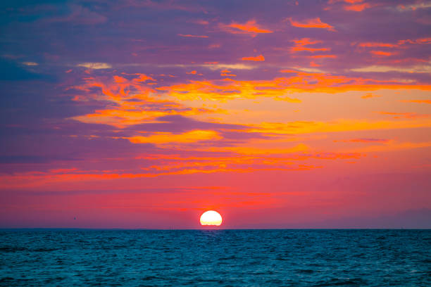 Dramatic sunset at summer over Baltic sea stock photo
