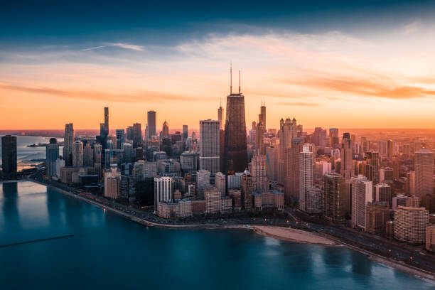 Dramatic Sunset - Downtown Chicago Aerial Dramatic View of Downtown Chicago at Sunset - Lake Shore Drive chicago stock pictures, royalty-free photos & images