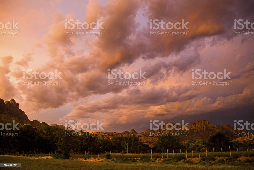 Dramatic Sunset glow on Storm Clouds Zion National Park Utah stock photo