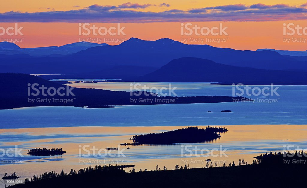 Dramatic Sunset in sweden on beautiful reflecting lakes stock photo