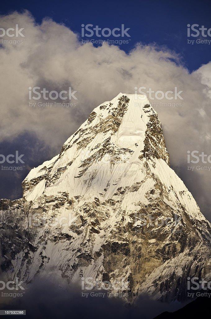 Dramatic sunset mountain peak snow glaciers Ama Dablam Himalaya Nepal royalty-free stock photo