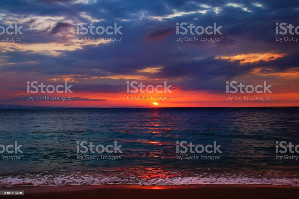 Dramatic sunset on the sea, Haiti stock photo