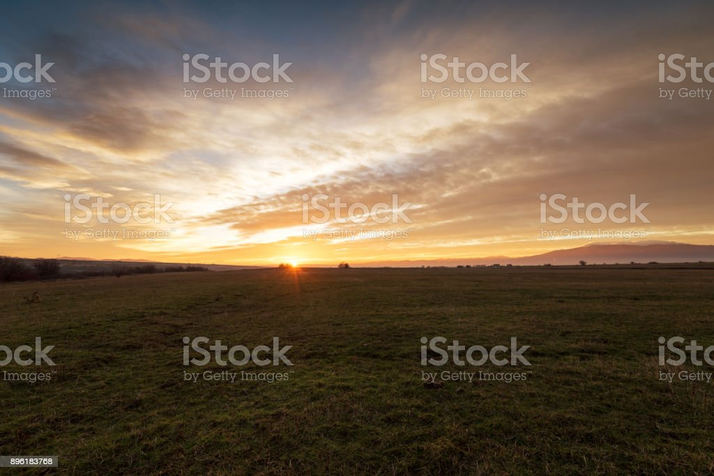Dramatic sunset over a field 5 stock photo