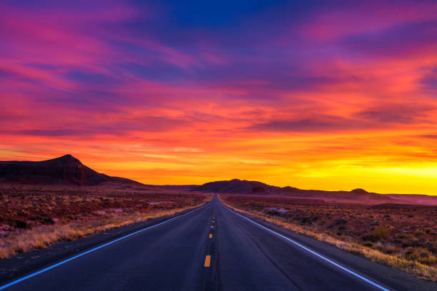 Dramatic sunset over an empty road in Utah stock photo