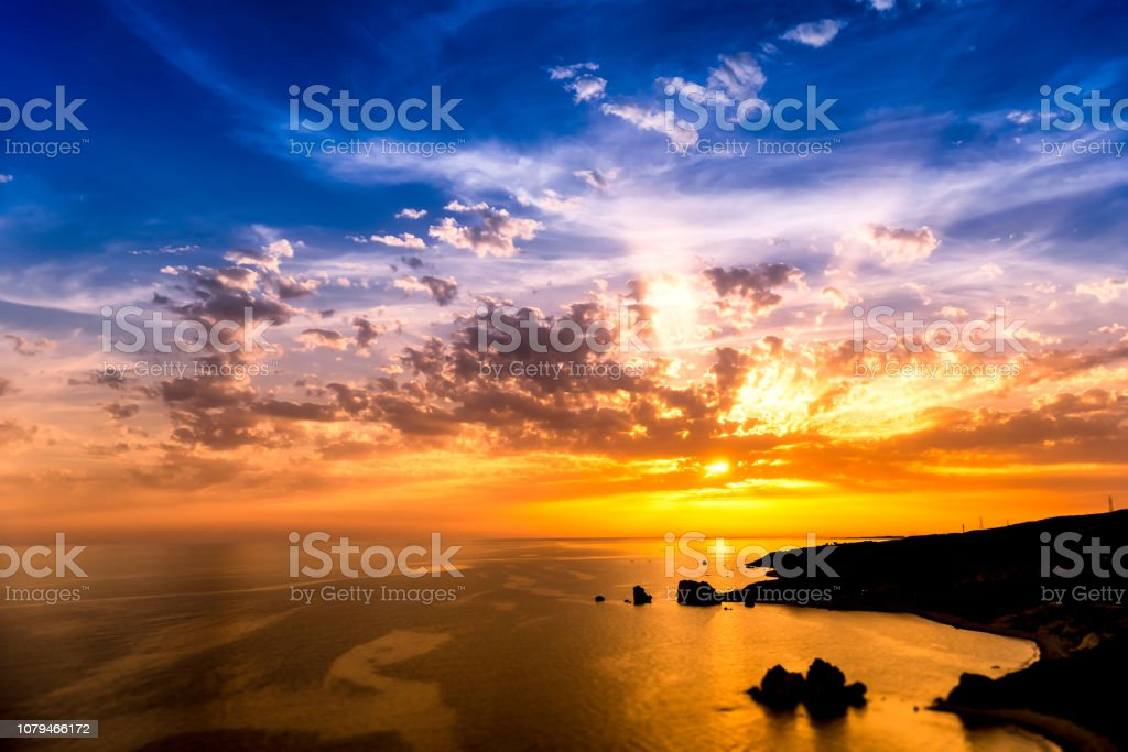 Dramatic sunset over Aphrodite's Rock also known as Rock of the Greek. Paphos District, Cyprus stock photo