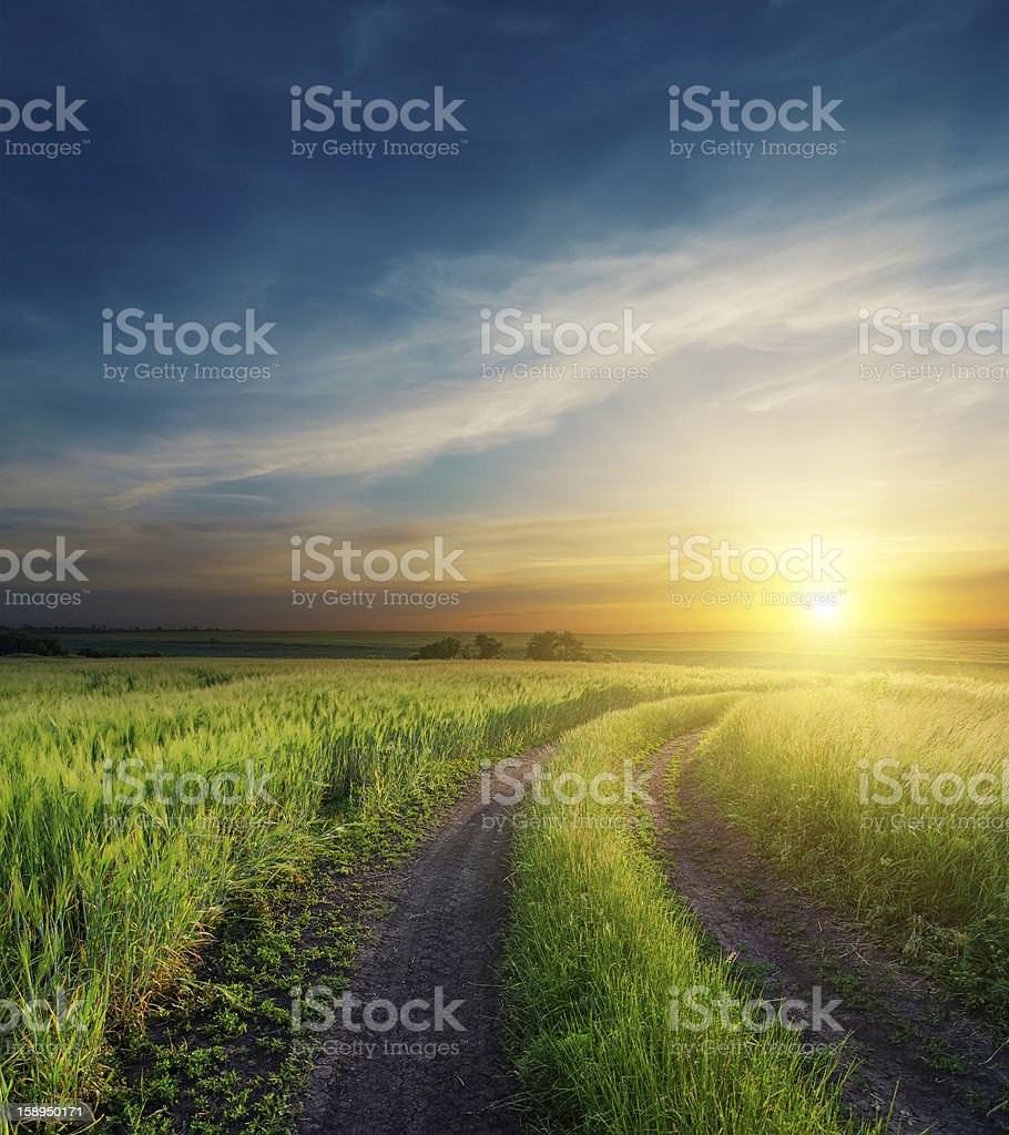 dramatic sunset over dirty road to horizon royalty-free stock photo
