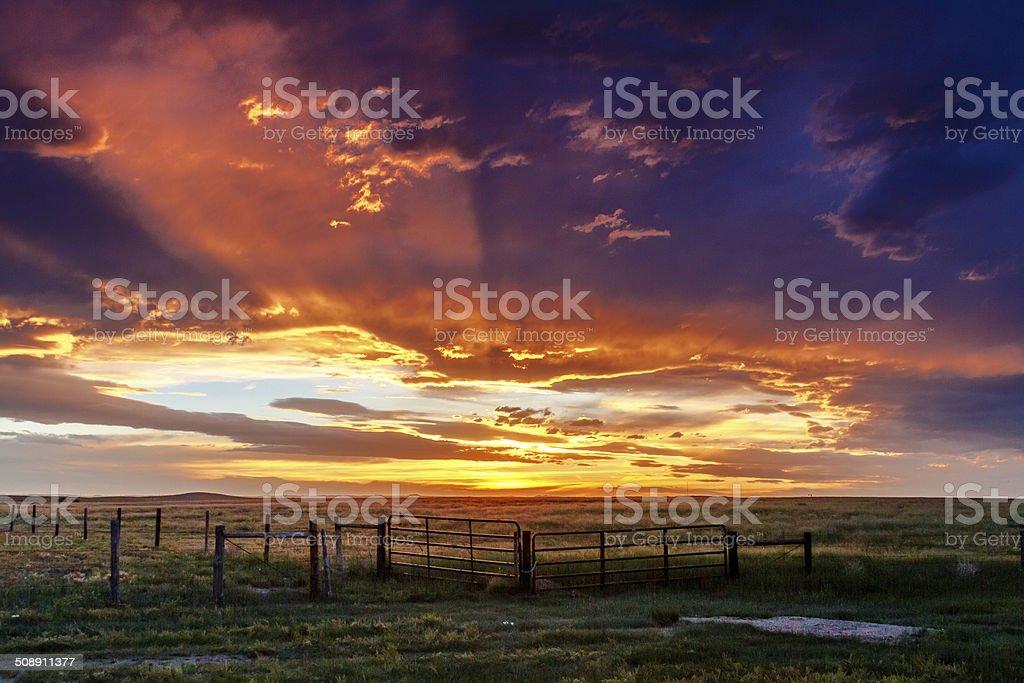 Dramatic Sunset Over Prairie stock photo