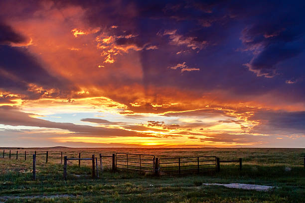 Dramatic Sunset Over Prairie stock photo