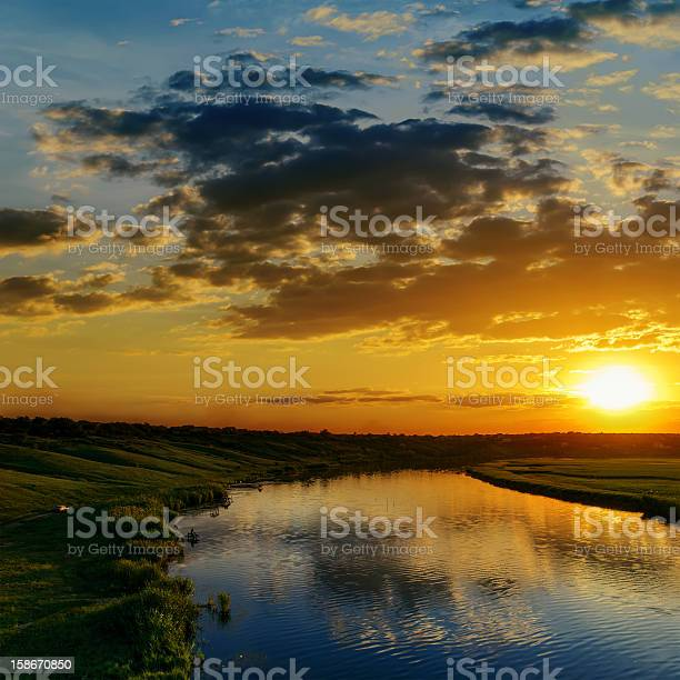 Photo of dramatic sunset over river