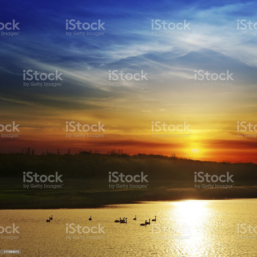 dramatic sunset over river royalty-free stock photo