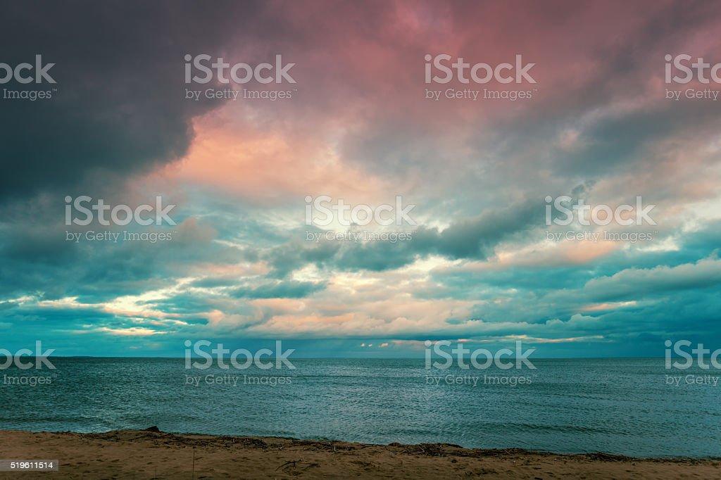 Dramatic sunset over sea stock photo