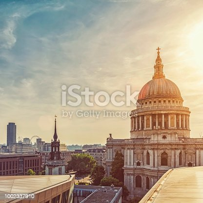 Dramatic sunset over St Paul's Cathedral and London Eye