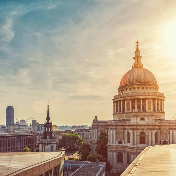 Dramatic sunset over St Paul's Cathedral and London Eye Dramatic sunset over St Paul's Cathedral and London Eye place of worship stock pictures, royalty-free photos & images