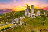 istock Dramatic sunset over the Corfe Castle, Dorset, England 1294566013