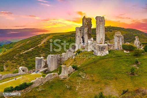 istock Dramatic sunset over the Corfe Castle, Dorset, England 1294566013