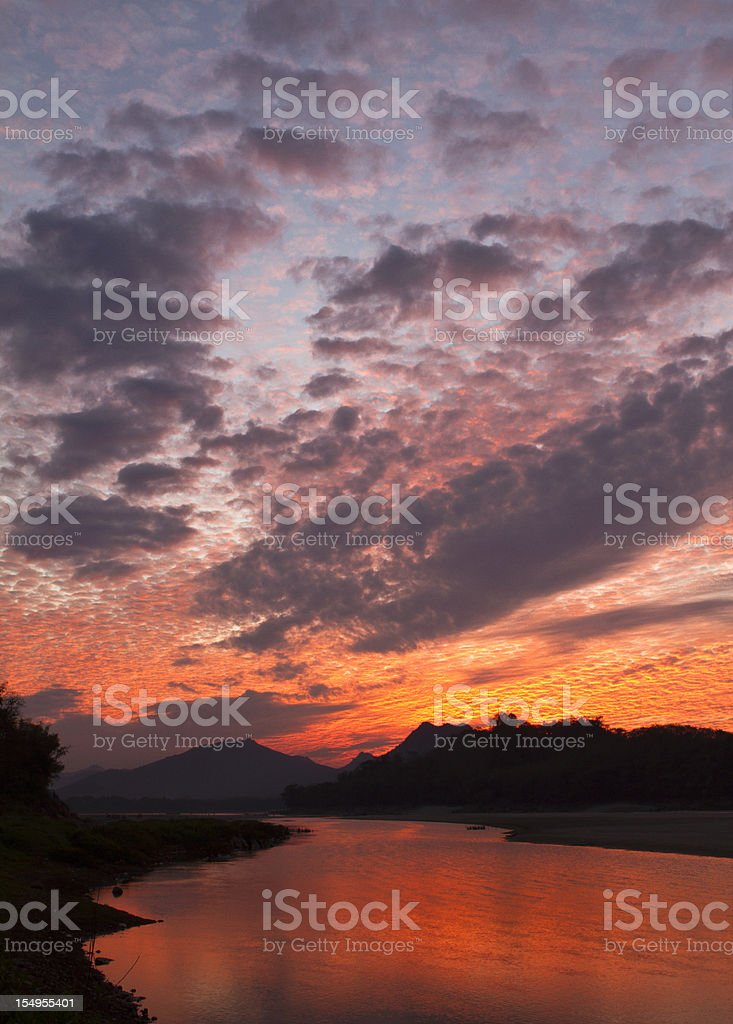 Dramatic sunset over the Mekong river in Laos stock photo