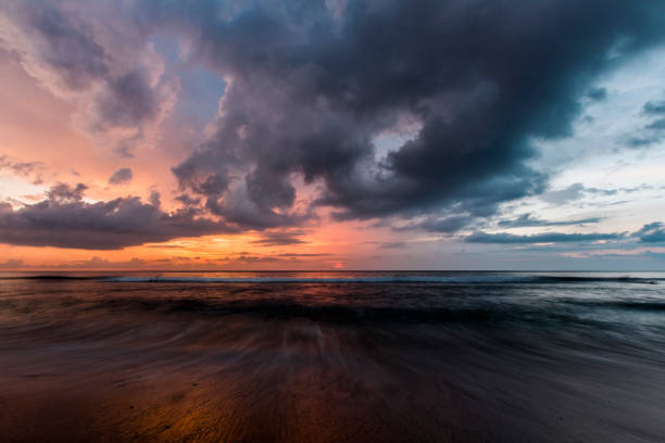 dramatic sunset over the sea - dramatic sky stock photos and pictures