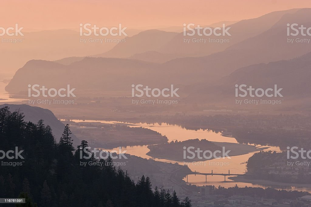 Dramatic sunset over Thompson River, distant hazy hills, Kamloops stock photo