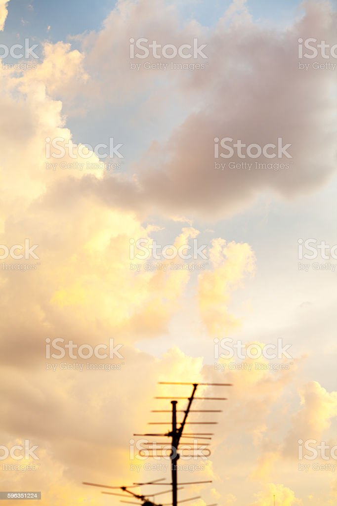 Dramatic sunset sky and tv antenna royalty-free stock photo
