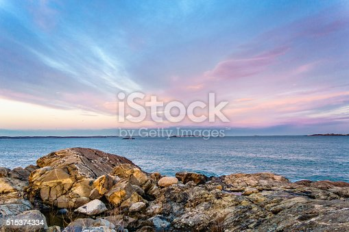 dramatic sunset sky with rocks in foreground