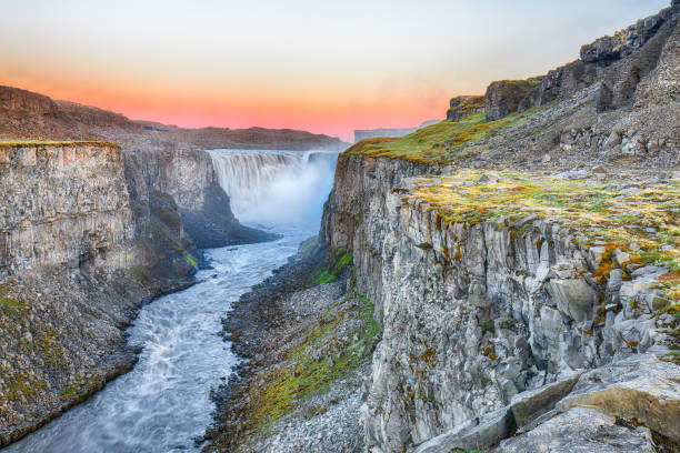 Dramatic sunset view of fantastic waterfall in Iceland stock photo