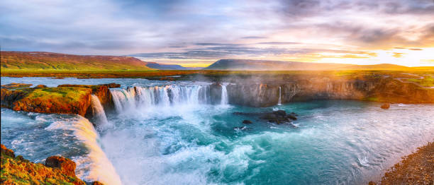 Dramatic sunset view  of waterfall in Iceland stock photo