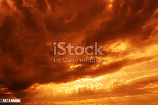 istock Dramatic sunsets sky yellow red clouds 680135698