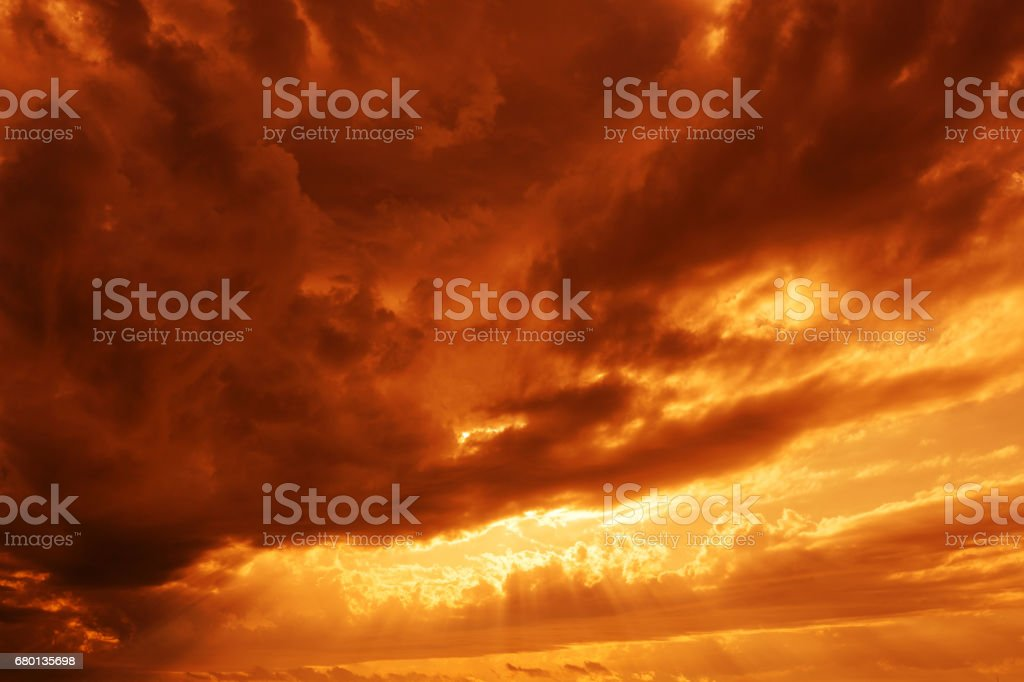 Dramatic sunsets sky yellow red clouds stock photo