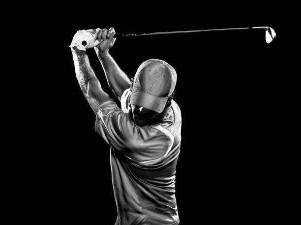 dramatic swing - golf stock photos and pictures