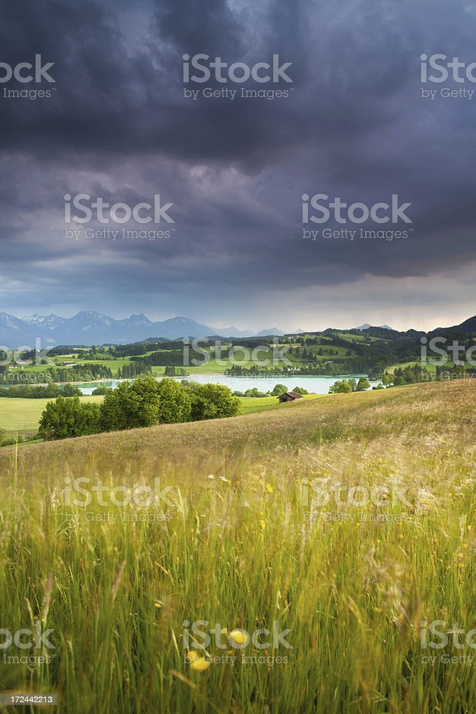 dramatic thunderstorm approaching from the alps, allgäu, bavaria, germany royalty-free stock photo