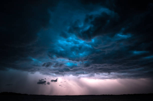 dramatic thunderstorm. - atmospheric mood stock photos and pictures