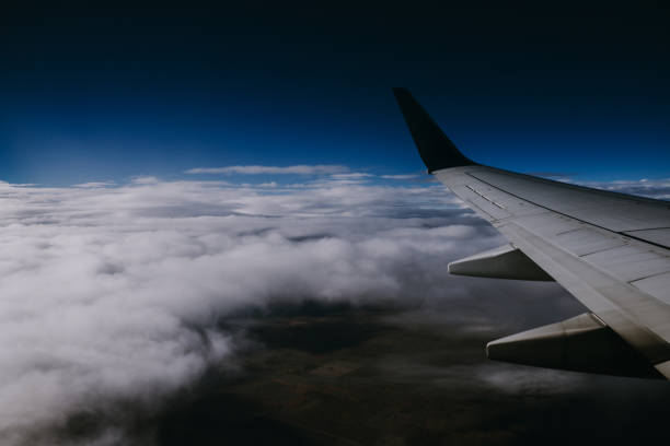 Dramatic View from an Airplane on a Cloud Day stock photo