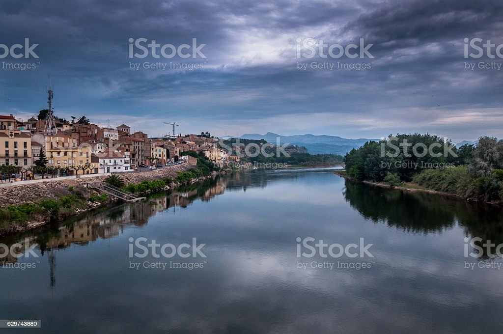 Dramatic view of a river with cloudy sky stock photo