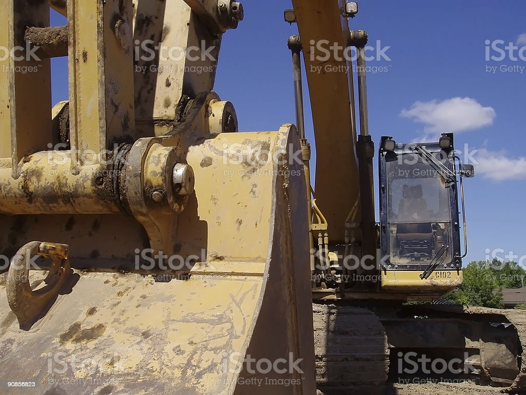 Dramatic view of an earth digger stock photo