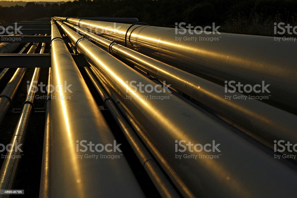 dramatic view of steel pipes in oil refinery stock photo