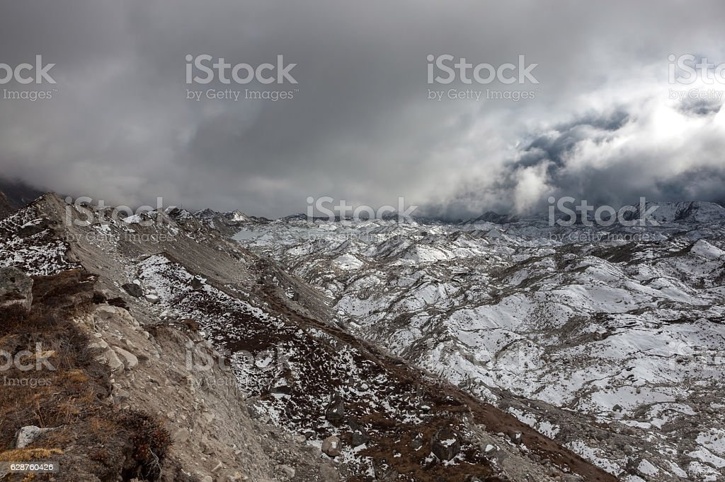 Dramatic view over gloomy Ngozumpa glacier in Sagarmatha stock photo