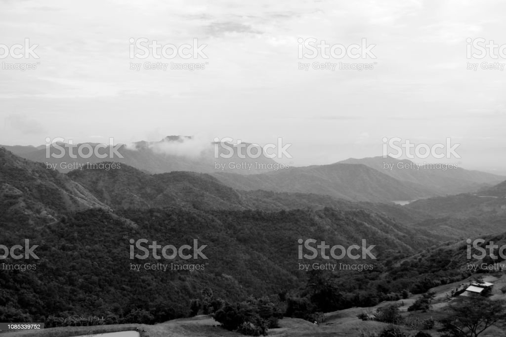 Dramatic weather conditions, mountain landscape in black and...