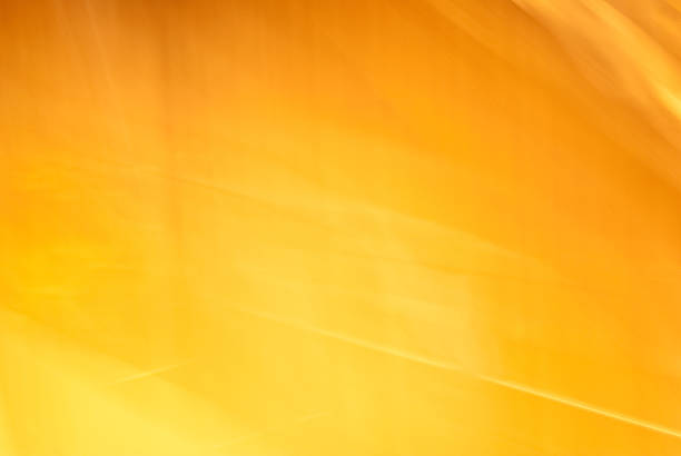 Dramatic yellow-orange light texture or background stock photo
