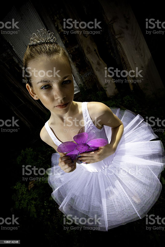 Dramatic Young Princess Holding a Flower royalty-free stock photo