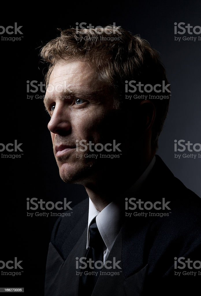 dramaticly lit man stock photo