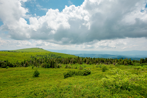 dramatyc mountain landscape at high noon. clouds above the ridge and hills on a sunny day. wonderful nature scenery in summertime